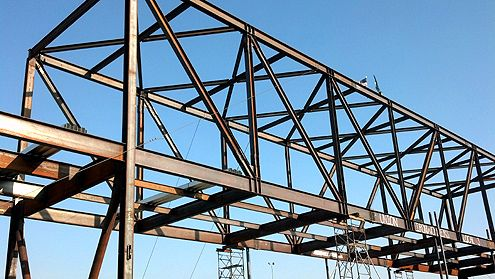 A closer view of the structural steel beams forming the internal framing of the One Santa Fe mixed-use project