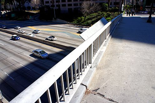 The short railings (about 3 feet tall) make it feel unsafe to walk across, especially for taller people