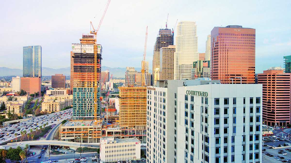 First metropolis high rise tower tops off in downtown la for Highrise apartments in los angeles